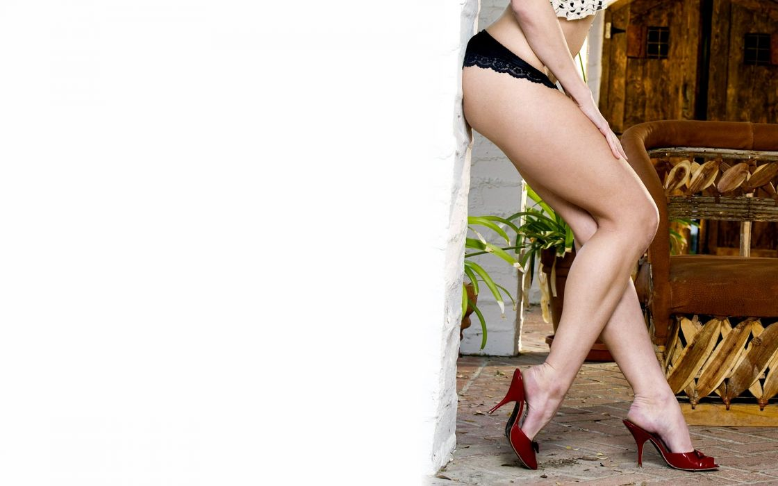 SENSULAITY - girl posed legs shoes wall wallpaper