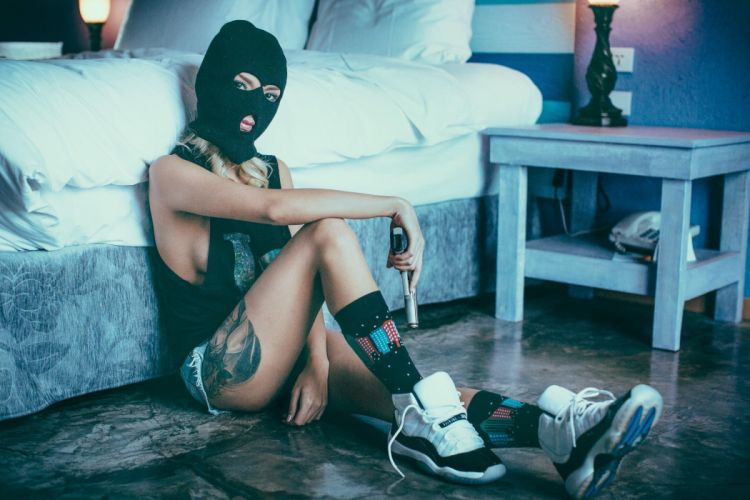 WOMEN AND GUNS - girl thug jeans mask tattoo pistol wallpaper