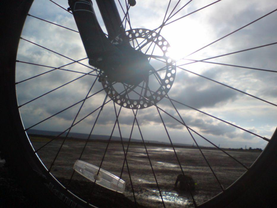 sun through bike disc 1 wallpaper