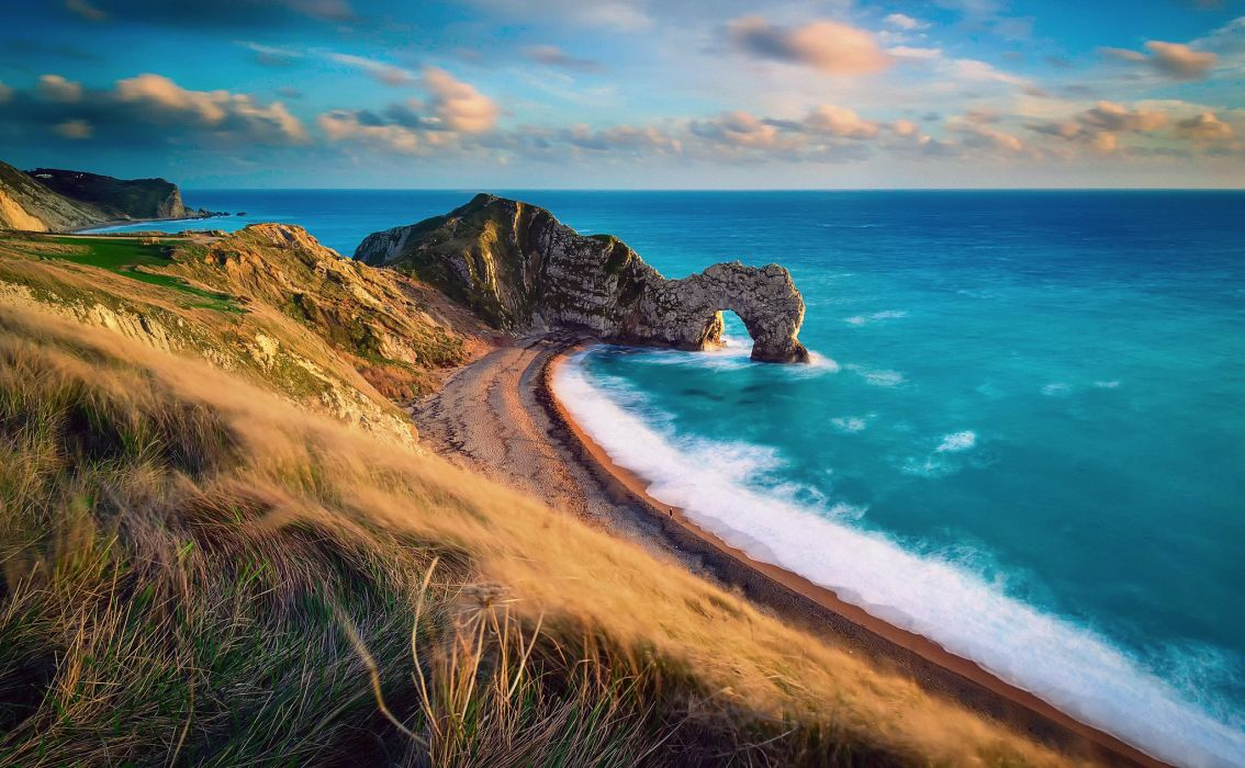 Durdle Door Jurassic Coast Dorset England English Channel coast rock arch gate Strait sea ocean beach wallpaper