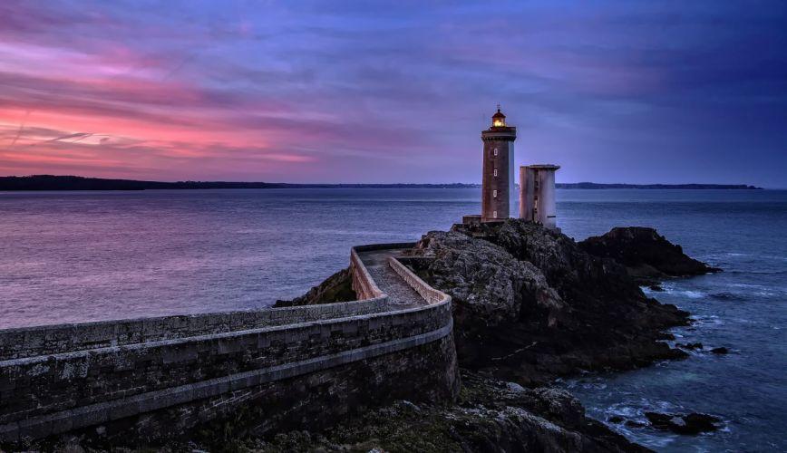 Scenery sea rocks lighthouse sunset sky wallpaper