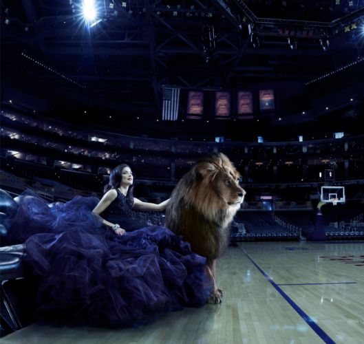 arena model brunette navy blue dress lion wallpaper