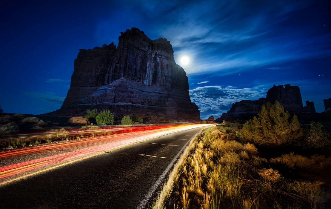 Arches National Park Utah USA street street lights rocks arches shrubs night moon stars sky nature landscape wallpaper
