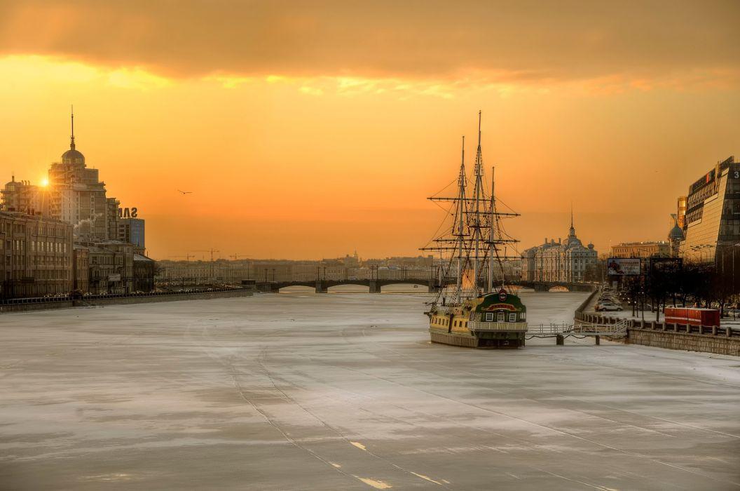 St Petersburg Russia sunrise sun sky bird city buildings streets river frozen ice ship sailboat imprisoned panorama wallpaper