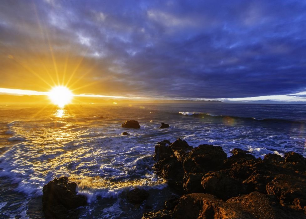 sunset sea rocks waves landscape wallpaper