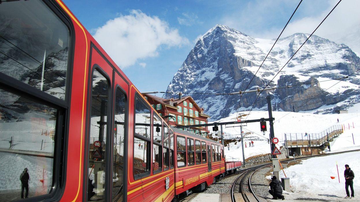 Jungfraubahn at Kleine Sheidegg Switzerland by North Face of Eiger wallpaper