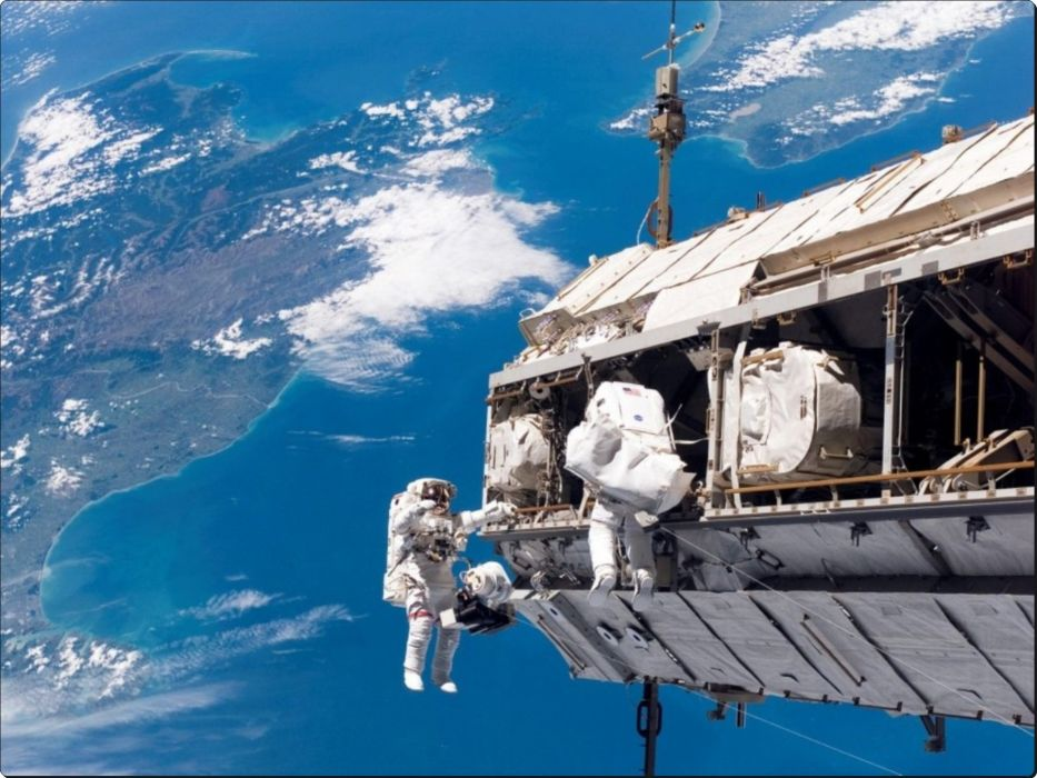 Spacewalk Outside the International Space Station wallpaper