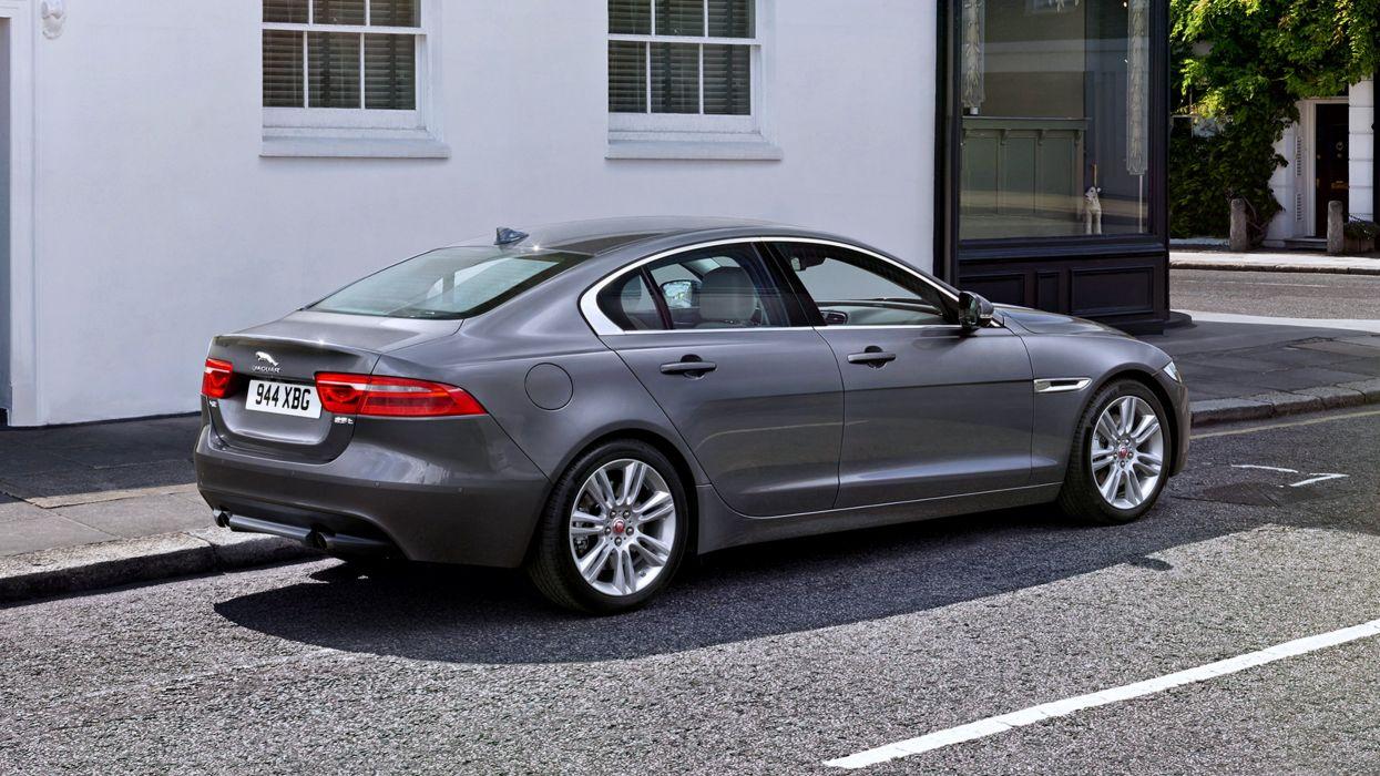 2015 Jaguar XE Portfolio gray city trees street cars motors speed wallpaper