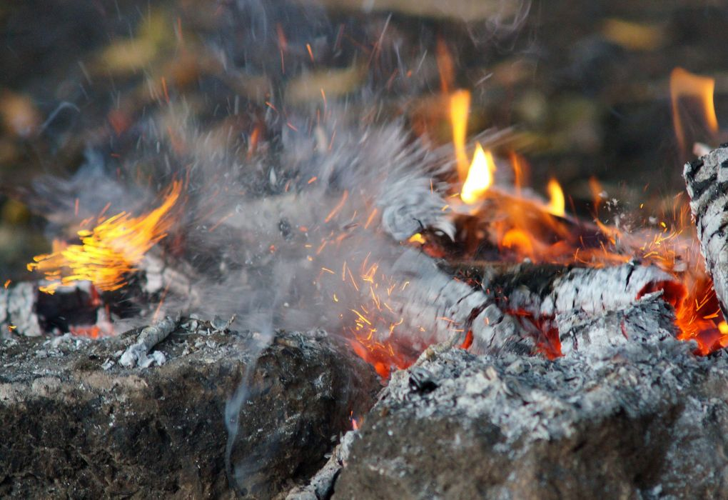 fire stones wood sparks flames forest wallpaper