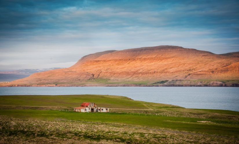 Iceland mountains bay sea water house lawn grass sky clouds landscape nature farm barn wallpaper