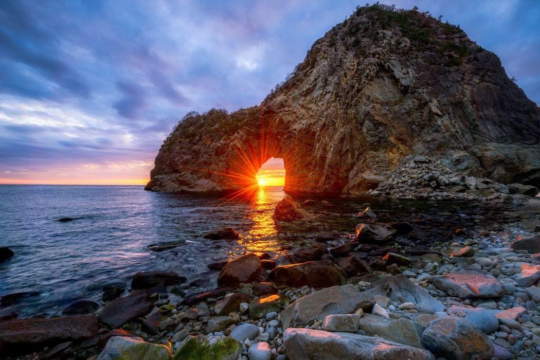 Sangamon Japan sea beach rock arches sun rays sunset sky nature landscape wallpaper