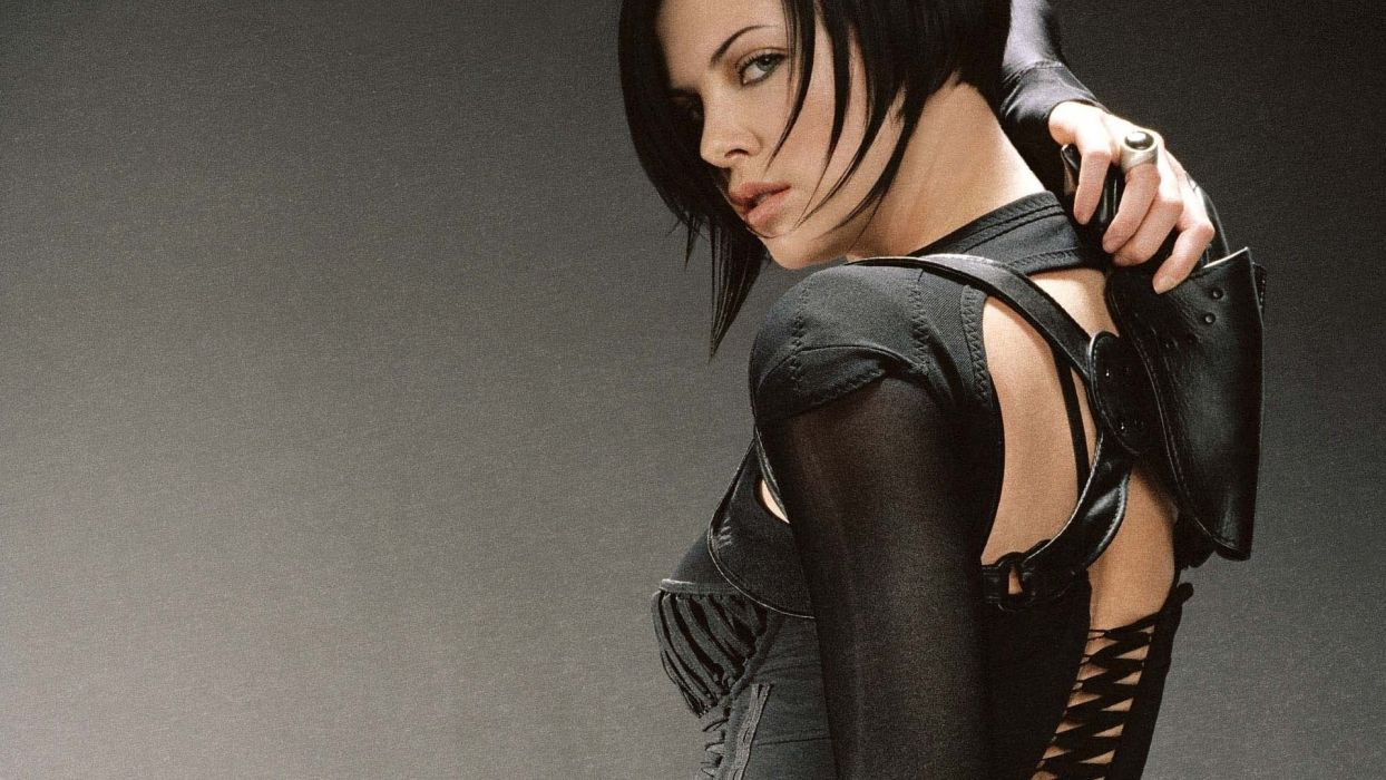 WOMEN AND GUNS - Charlize Theron actress girl black hair pistol wallpaper
