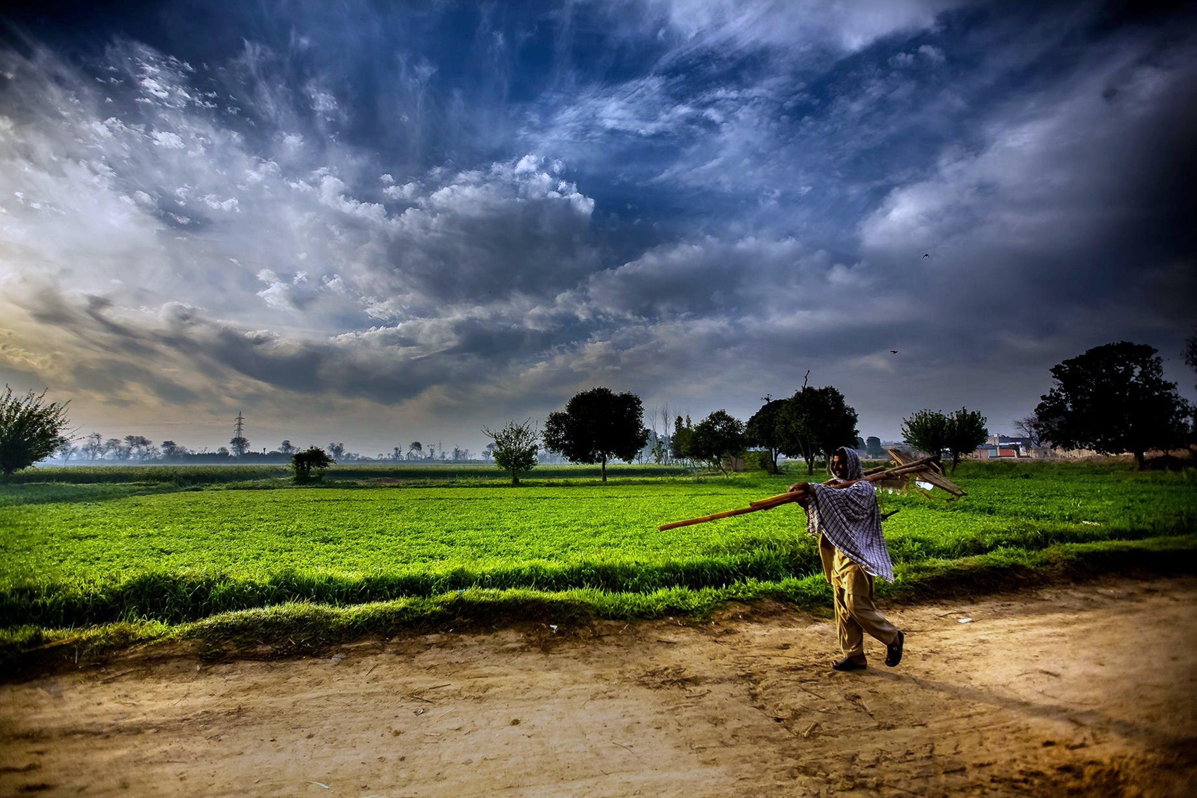 pakistan landscapes man farmer agriculture clouds sky
