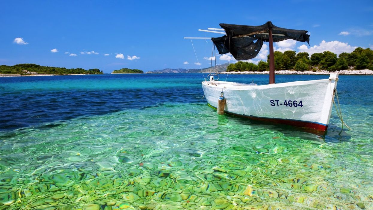 Yacht boat stones sea beaches sky blue trees islands summer relax quiet landscapes nature wallpaper