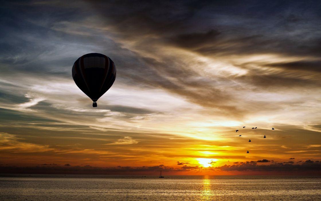 Zeppelin air balloon landscapes sunset sky clouds birds nature sea beauty boats wallpaper