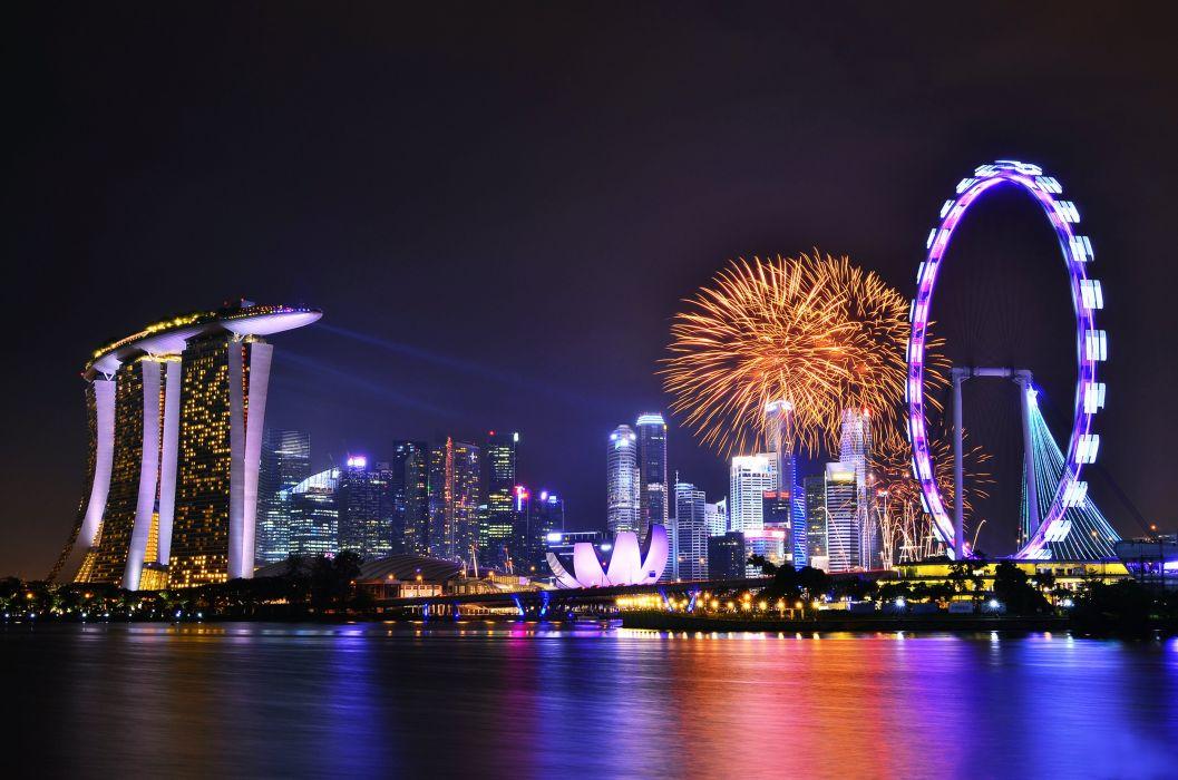 Singapore fireworks celebrations festivals lights skyscrapers hotels city sea port buildings park fun joy enjoying Wheel Globalization evolution technology wallpaper