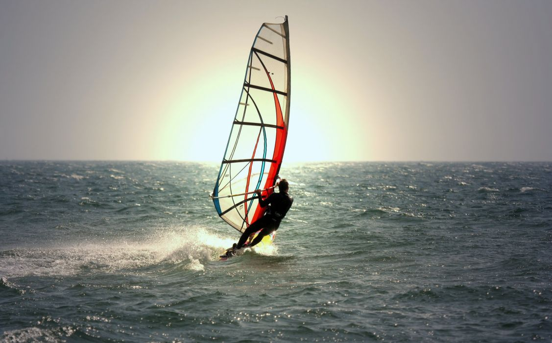 sky sea ocean waves sun nature earth sports Windsurfing man fun joy wallpaper