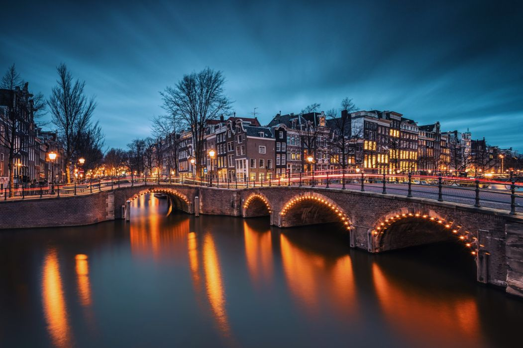 buildings amsterdam City nederland evening Globalization hotels Lights Park port Sea sky trees clouds bridge wallpaper