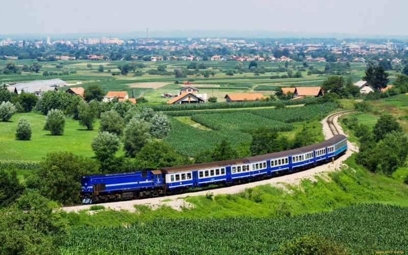 landscapes old railroad sky Sunny trains hills grass sunny motors speed green countryside houses town blue trees wallpaper