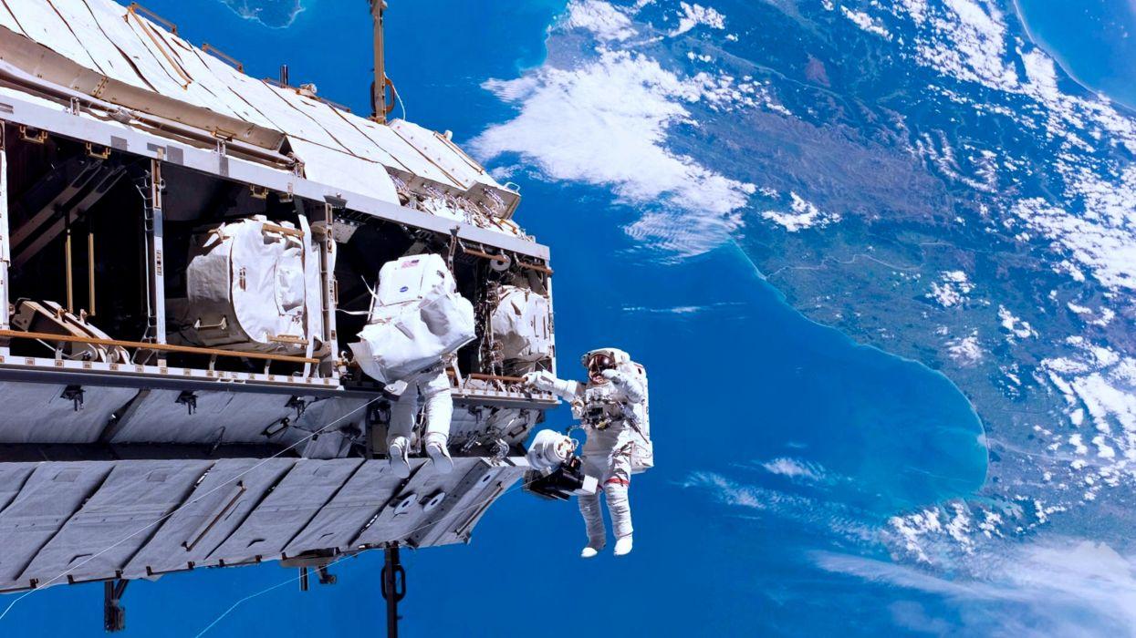 Astronauts unpack satellite base space shuttle sky earth technology NASA wallpaper