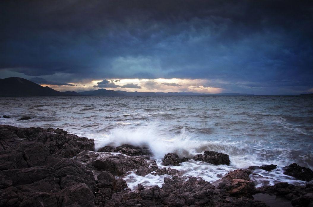 sea mountains clouds rocks splashing waves ocean shore wallpaper