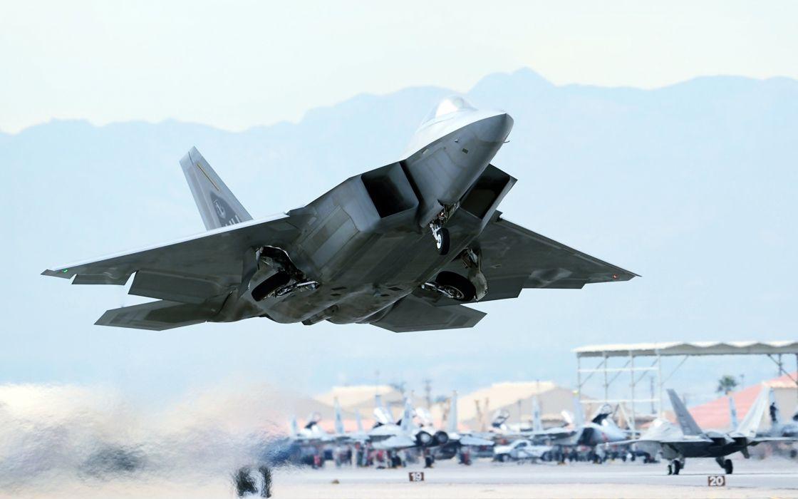F-22 Raptor aircrafts weapons fighters planes airport army military wars wallpaper