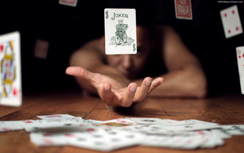 HANDS - girl showing magic flying joker card wallpaper