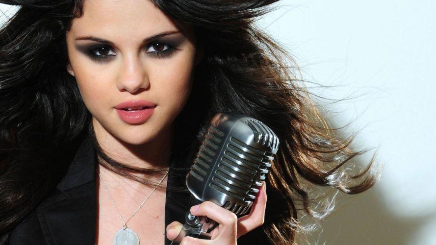 Selena Gomez women girls brunette singer microphone hair wallpaper