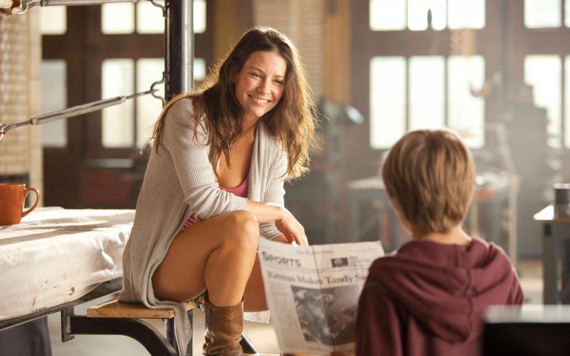 sensuality Evangeline Lilly legs smiling newspapers boots children women girls brunette wallpaper