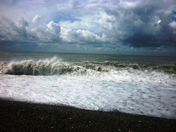 Black sea storm clouds beach waves ocean wallpaper
