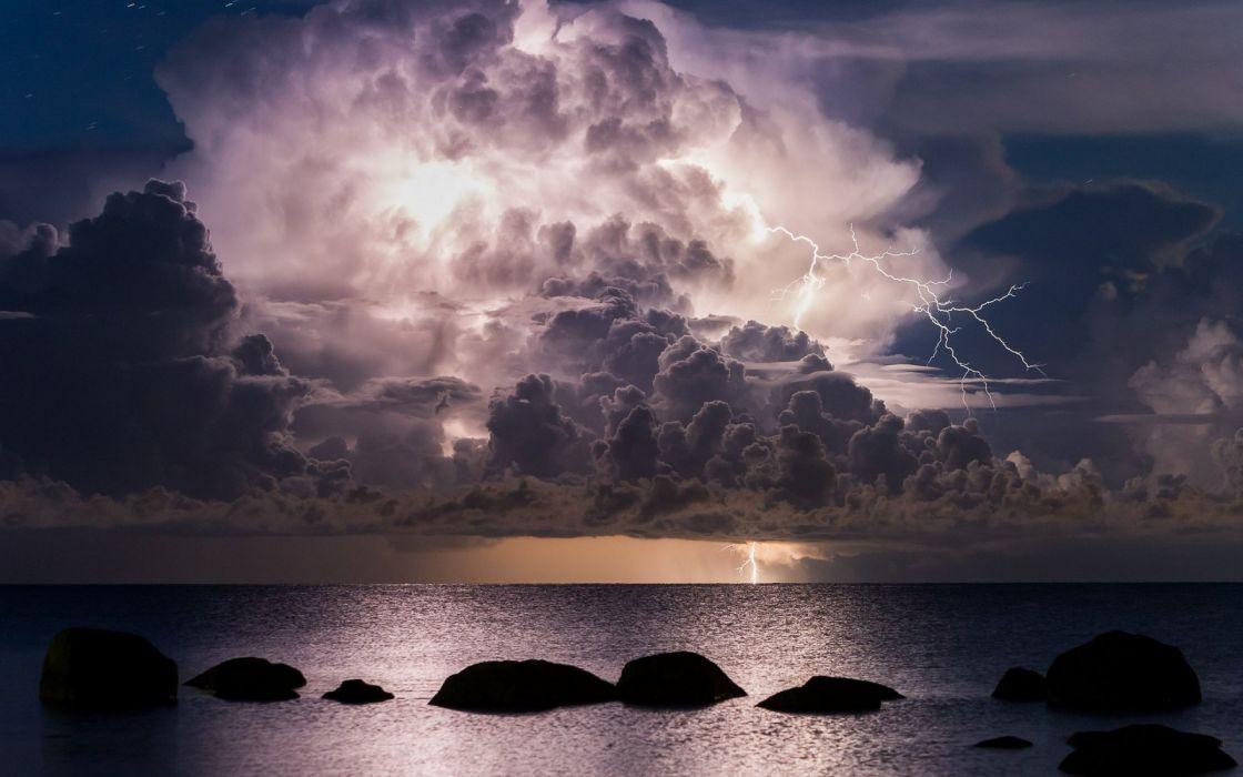 storm lightning ocean sea clouds sky wallpaper
