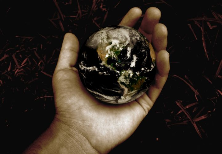Styles hand ball earth planet wallpaper