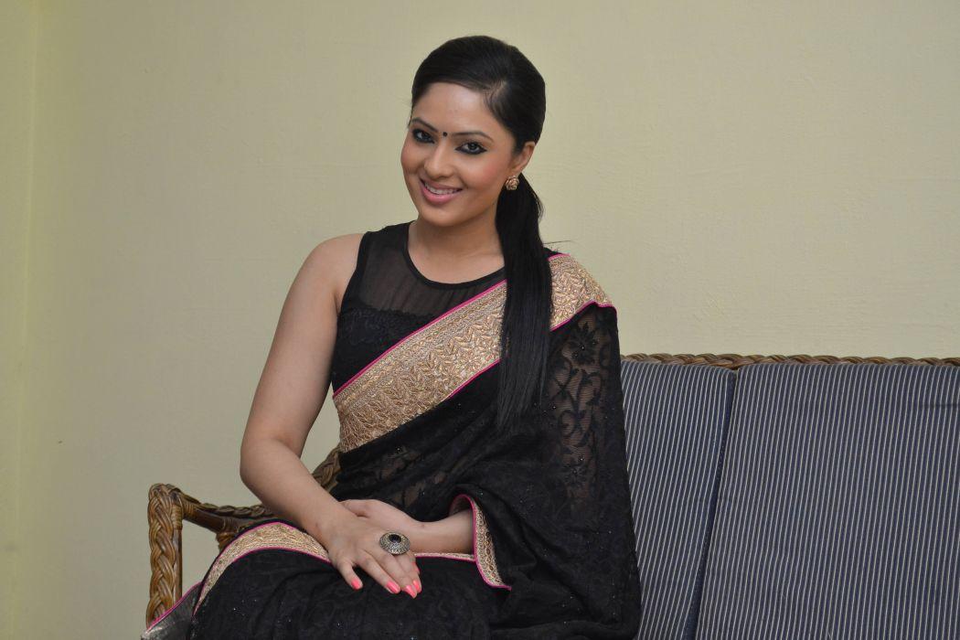 Nikesha-Patel-Latest-Stills-In-Black-Saree-07 wallpaper