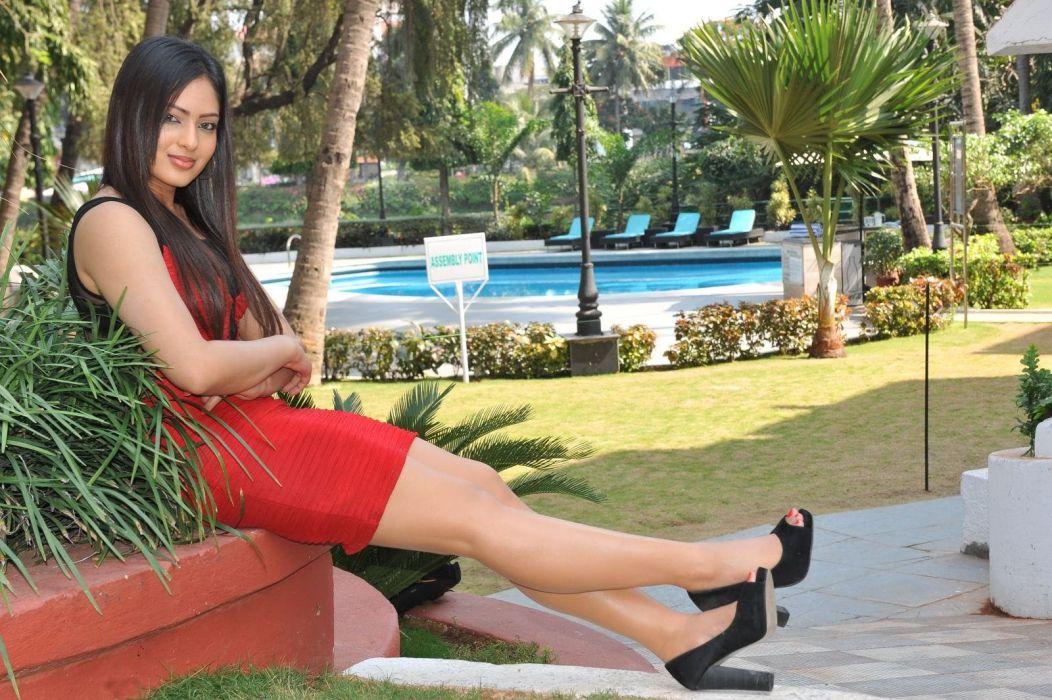 nikesha-patel-latest-hot-shoot-red-dress-exposing-smooth-legs wallpaper