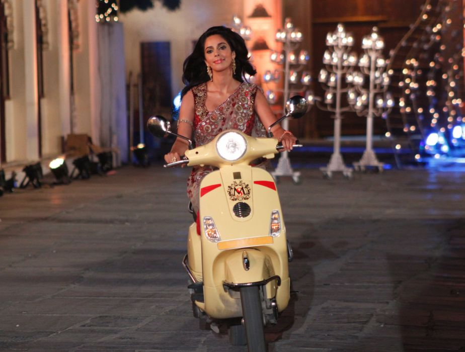 mallika-sherawat-rides-the-scooty-with-ms-imprinted-on-it wallpaper