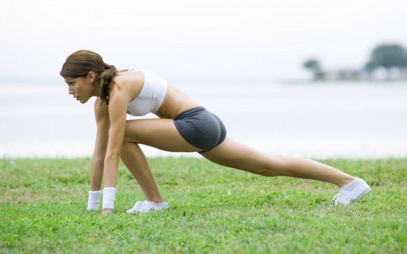 Sports girl extension training grass feet purpose wallpaper