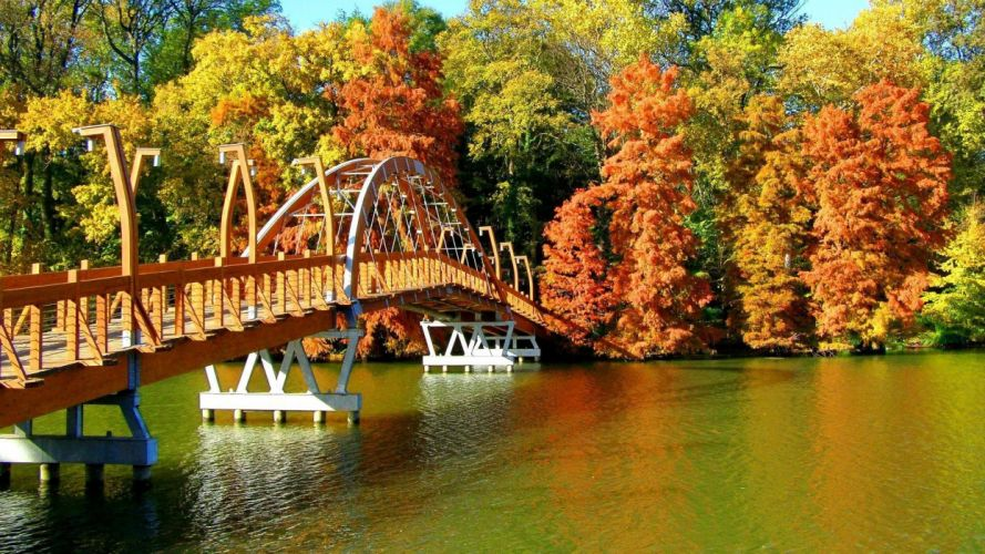 Beautiful Bridge Over River In Autumn wallpaper