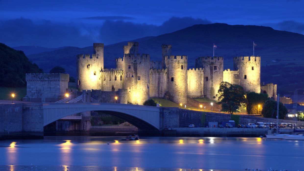 England Conwy Castle North Wales England North Wales castle fortress bridge river mountain night evening lights landscape wallpaper