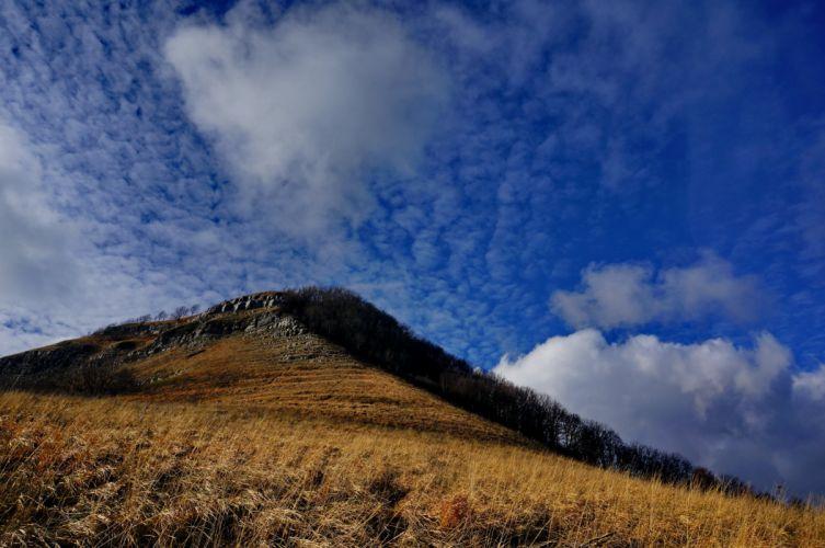 sky top mountain autumn clouds grass climbing wallpaper