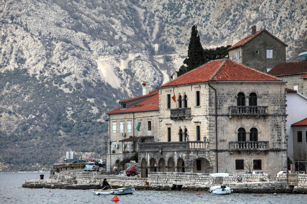 Montenegro the mountain slopes lake boats building hotel wallpaper