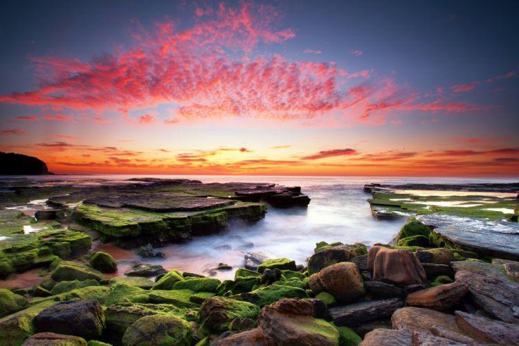 Stones algae sunset clouds water wallpaper