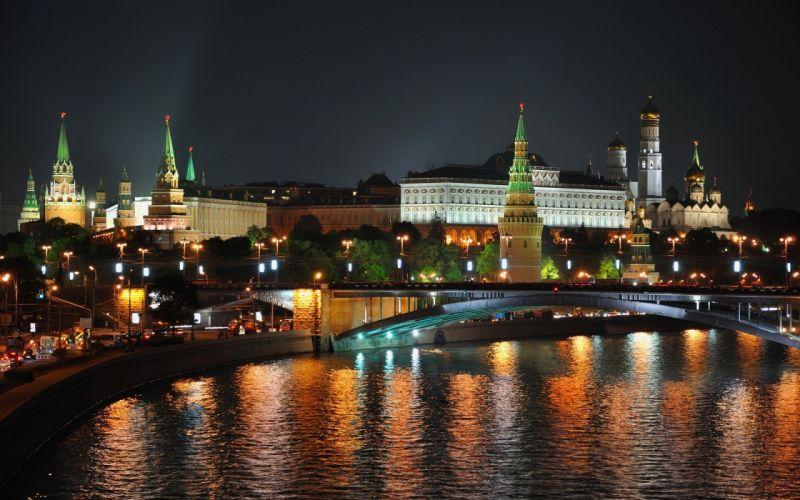 ciudad noche mar edificios luces wallpaper