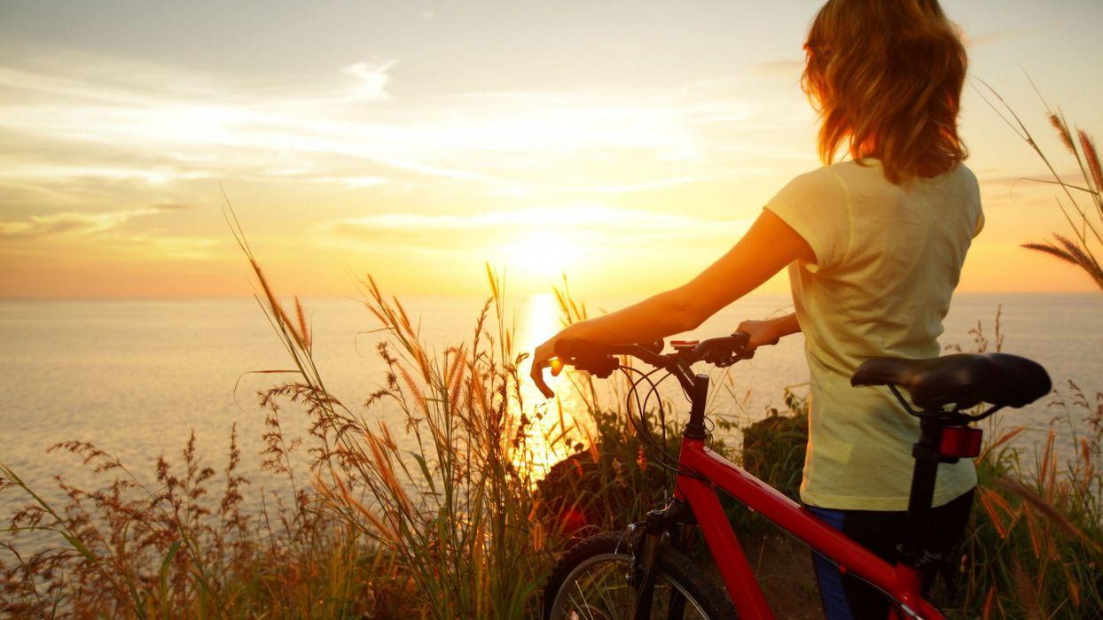sunset bike girl female summer sea wallpaper