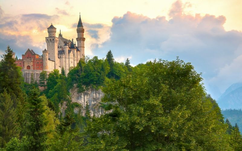 Germany Castles Mountains Neuschwanstein Bavaria Trees Clouds Cities wallpaper