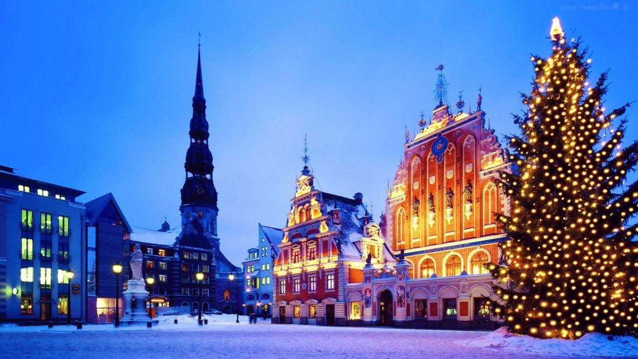 Riga Latvia buildings houses church bell tower square tree tree lights night sunset city wallpaper