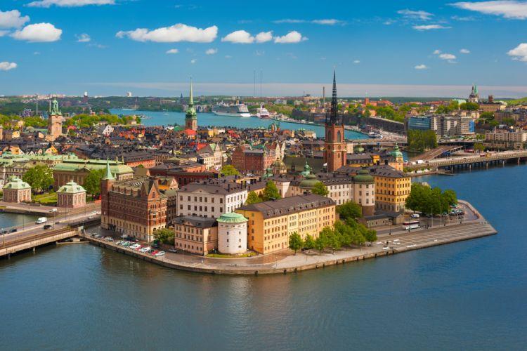 Sweden Rivers Bridges Houses Sky Stockholm Waterfront Riddarholmen Gamla stan Riddarholm Church Cities wallpaper