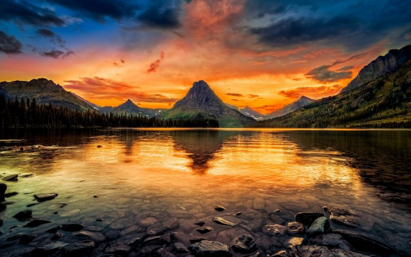 USA Two Medicine Lake Glacier National Park forest mountain lake rocks trees sky glow sunset wallpaper