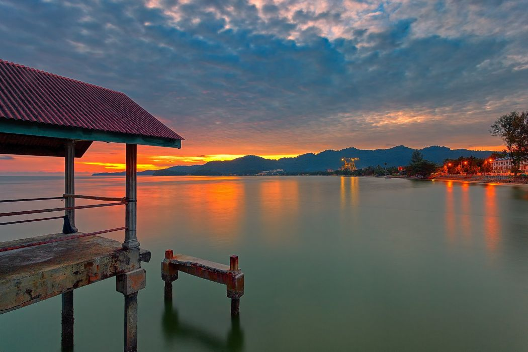 sky clouds sunset mountains lake house lights pier wallpaper