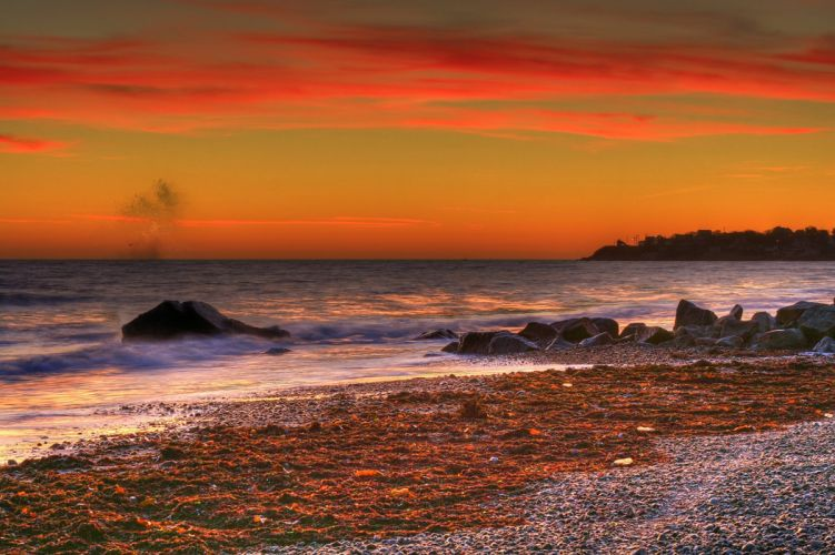 sky clouds glow sea beach stones wallpaper