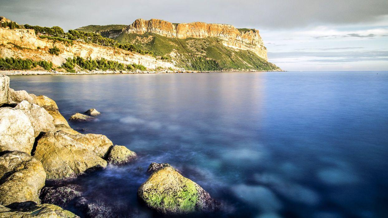 sky clouds sea stones rock cape wallpaper